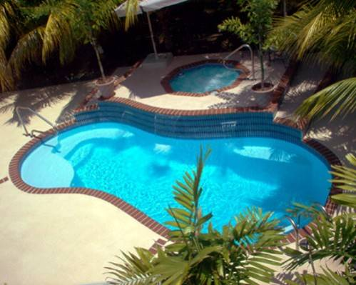 Kidney pools kidney pool swimming pool quotes for Images of kidney shaped pools