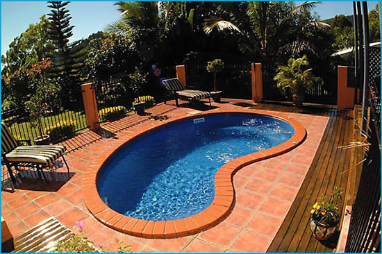Kidney shaped pool designs swimming pool quotes for Above ground pool decks tulsa