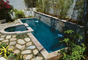 rectangle pool with elevated overflow spa